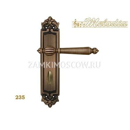 Дверная ручка на планке под фиксатор MELODIA mod. 235 MIRELLA WC матовая бронза